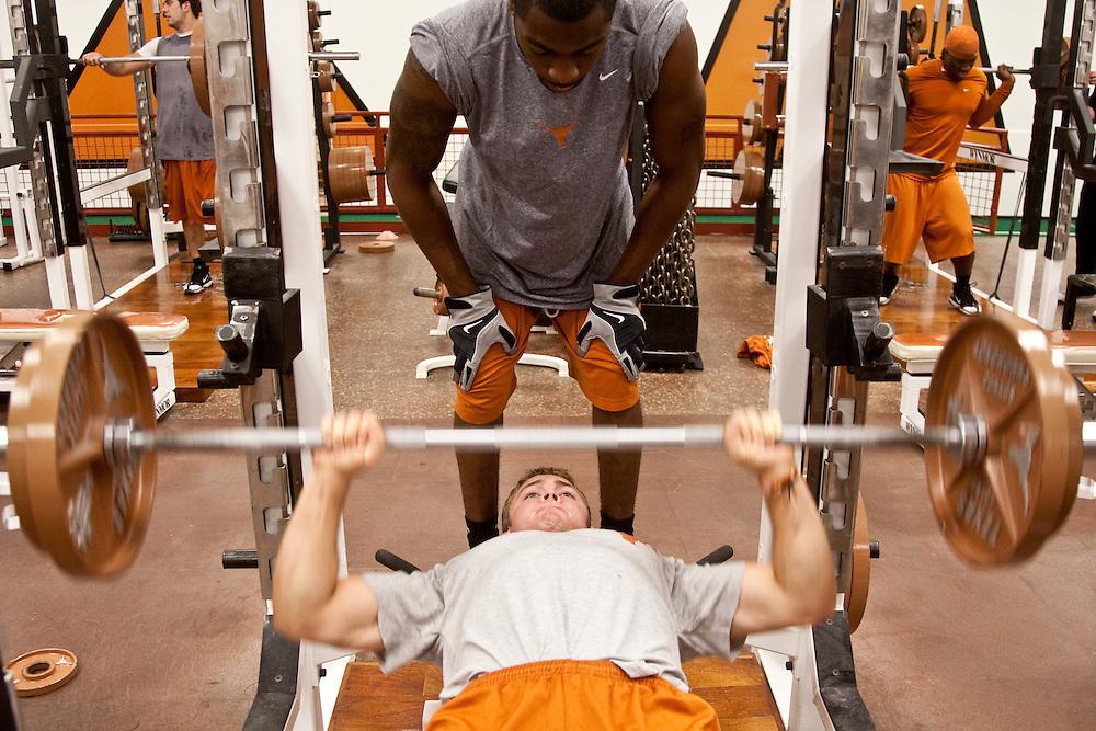 Colt McCoy, quarterback, lifts weights during workout. University of Texas Longhrons football team weight training session. Moncreif-Neuhaus athletic center, The University of Texas at Austin. Austin, Texas, April 27 2009. Photograph © 2009 Darren Carroll