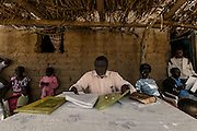 Tchikuteny is responsible for the management of the village. In Angola?s Namibe desert, at Giraul, in the Namibe province, Tchikuteny, from the Mucubal tribe, is the leader of a big family, maybe the biggest family in the world.<br /> He is the chief leader, the manager and responsible for the entire village. <br /> In his village, Tchikuteny lives nowadays with most of his big family, his 33 wives, that were once 43, but 10 left the village, and most of their descendants.<br /> Tchikuteny maintains the registry of all the new-borns, totalizing 154 sons, and his grandsons, that are around 60. Nowadays, 4 new babies are on the way, and 3 great grand children were born recently.<br /> Huge harmony, love and respect transpire in the village atmosphere. The sense of a community is the pillar of their sustainability and sustenance and their autonomy depends prominently on cattle and agriculture that is made by the villagers. Nevertheless, Tchikuteny village is in close connection with their surrounding communities. Children attend Giraul School and there is proximity and relations with the extended family that lives in the surroundings.<br /> Being the spiritual leader of the community, Tchikuteny is also responsible for the weekly religious works that happens in the village church. <br /> This big family opened his doors to share with us their daily lives.