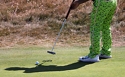 General view of a golfer wearing colourful trousers putting on the 2nd green during day one of The Open Championship 2018 at Carnoustie Golf Links, Angus. PRESS ASSOCIATION Photo. Picture date: Thursday July 19, 2018. See PA story GOLF Open. Photo credit should read: Richard Sellers/PA Wire. RESTRICTIONS: Editorial use only. No commercial use. Still image use only. The Open Championship logo and clear link to The Open website (TheOpen.com) to be included on website publishing.