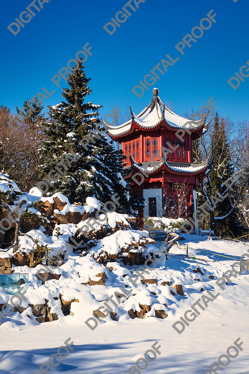 January 24, 2021 - Montreal Botanical Garden, Quebec, Canada - The Tower of Condensing Clouds at Chinese Garden in winter with snow - Montreal Botanical Garden