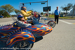 Riding up to the Harley-Davidson display at the Speedway during Daytona Bike Week, FL, USA. March 8, 2014.  Photography ©2014 Michael Lichter.
