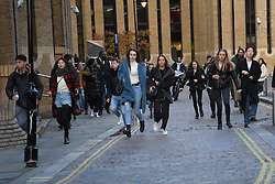 © Licensed to London News Pictures. 29/11/2019. London, UK.  A group of young women look emotional as they are evacuated from the scene. Emergency response agencies react to a major incident on London Bridge, evacuating nearby Borough Market and office blocks as shots are fired near a bus..  Photo credit: Guilhem Baker/LNP