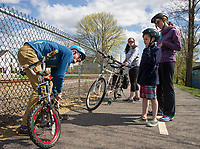 Myles Chase from MC Cycle helps cyclists along the Wow Trail in Laconia.  (Karen Bobotas Photographer)