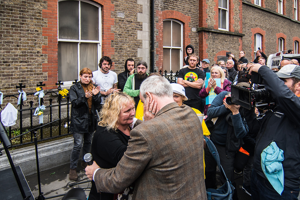 """Dublin, Ireland. 26th August, 2018. <br /> Colm O'Gorman hugs a mother of two children that died in the Madeleine Laundries after her speech at the Stand4Truth protest while is taking place the Holy Mass of the second of the two-days of the visit of Pope Francis in Dublin, Ireland.<br /> Pope Francis has made a two-day visit to the Republic of Ireland by celebrating a Mass at Dublin's Phoenix Park. The Argentine Pope asked forgiveness for the """"abuses in Ireland, abuses of power, conscience and sexual abuses"""" perpetrated by Church leaders. It was the first papal visit to Ireland for 39 years. During his activities many activists, victims and survivors have made protests and a silent march Garden of Remembrance towards the last Magdalene Laundry to close in Ireland.<br />  © Simone Padovani"""