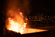 Demonstrators burn a dumpster  in front of the Lafayette square park in Washington, D.C on May 30, 2020 during the second day of demonstration against the death in Minneapolis of African-American man George Floyd. Photo by Akash Pamarthy