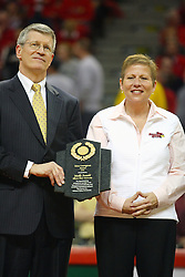 """31 January 2009: Missouri Valley Commissioner Doug Elgin presents Molly Arnold with the conferences Most Courageous Award.  Molly battle cancer. The Illinois State University Redbirds join the Bradley Braves in a tie for 2nd place in """"The Valley"""" with a 69-65 win on Doug Collins Court inside Redbird Arena on the campus of Illinois State University in Normal Illinois"""