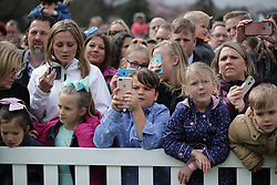 WASHINGTON, DC - APRIL 02: (AFP OUT) Children wait for the arrival of U.S. President Donald Trump during the 140th annual Easter Egg Roll on the South Lawn of the White House April 2, 2018 in Washington, DC. The White House said they are expecting 30,000 children and adults to participate in the annual tradition of rolling colored eggs down the White House lawn that was started by President Rutherford B. Hayes in 1878. (Photo by Chip Somodevilla/Getty Images)