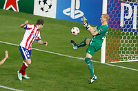 Atletico de Madrid´s Javier Manquillo (L) and Malmo´s goalkeeper Olsen during Champions League soccer match between Atletico de Madrid and Malmo at Vicente Calderon stadium in Madrid, Spain. October 22, 2014. (ALTERPHOTOS/Victor Blanco)
