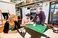 Furniture design professor Leó Jóhannsson instructing final-year design students.