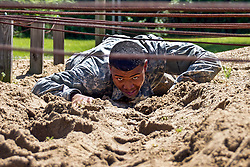 Sgt. Marc Doss with the Mississippi National Guard low crawls during the National Guard Region III Best Warrior Competition at the Wendell H. Ford Regional Training Center in Greenville, Ky., April 24, 2017. The three-day competition decided which Soldier and non-commissioned officer would compete against the best Guardsmen nationwide. (U.S. Army National Guard photo by Staff Sgt. Scott Raymond)