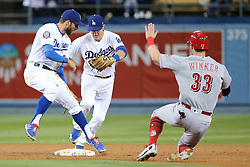 May 11, 2018 - Los Angeles, CA, U.S. - LOS ANGELES, CA - MAY 11: Los Angeles Dodgers Infield Chris Taylor (3) tries to get out of the way of Los Angeles Dodgers Infield Chase Utley (26) so Utley can get the force out before Cincinnati Reds Outfield Jesse Winker (33) can get to second base in the game between the Cincinnati Reds and the Los Angeles Dodgers on May 11, 2018 at Dodger Stadium in Los Angeles, CA.. (Photo by Peter Joneleit/Icon Sportswire) (Credit Image: © Peter Joneleit/Icon SMI via ZUMA Press)
