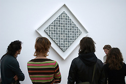 Visitors looking at painting by Piet Mondriaan at the Gementemuseum or city museum in The Hague The Netherlands