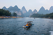 China, Yangshuo County, Bamboo rafts on the Yulong River Karst formations