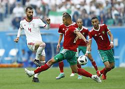 June 15, 2018 - Saint Petersburg, Russia - Group B Morocco v IR Iran - FIFA World Cup Russia 2018..Roozbeh Cheshmi (Iran) and Romain Saiss (Morocco) at Saint Petersburg Stadium , Russia on June 15, 2018. (Credit Image: © Matteo Ciambelli/NurPhoto via ZUMA Press)