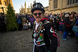 © London News Pictures. 01/05/2016. Oxford, UK. A Morris Man performs a dance with other Morris dancers outside Radcliffe Camera in Oxford, Oxfordshire in the early hours of the morning, to celebrate May Day. This year people were again prevented from jumping from the bridge in to the water due to injuries sustained at a previous years event . Photo credit: Ben Cawthra/LNP