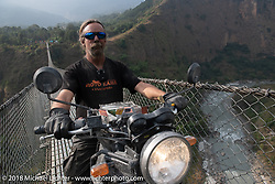 Round the World Doug Wothke on the Kusma Gyadi Bridge, the tallest (443') and one of the longest (1,128') suspension bridges in the country, on Day-7 of our Himalayan Heroes adventure riding from Tatopani to Pokhara, Nepal. Monday, November 12, 2018. Photography ©2018 Michael Lichter.