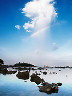Rainbow over a rocky shore in Nha Trang area, Vietnam, Southeast Asia