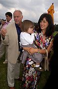 Polly Sampson, David Gilmour and their daughter, Veuve Clicquot gold Cup, Polo at Cowdray, 18 July 2004. SUPPLIED FOR ONE-TIME USE ONLY> DO NOT ARCHIVE. © Copyright Photograph by Dafydd Jones 66 Stockwell Park Rd. London SW9 0DA Tel 020 7733 0108 www.dafjones.com