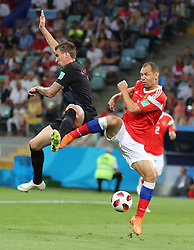 SOCHI, July 7, 2018  Sergey Ignashevich (R) of Russia competes during the 2018 FIFA World Cup quarter-final match between Russia and Croatia in Sochi, Russia, July 7, 2018. (Credit Image: © Yang Lei/Xinhua via ZUMA Wire)