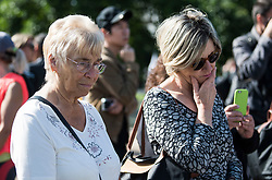 © Licensed to London News Pictures. 31/08/2017. London, UK. Members of the public look at fowers and tributes left at the gates to Kensington Palace in London on the 20th anniversary of the death of Diana, Princess of Wales. Princess Diana was fatally injured in a car crash along with her companion Dodi Fayed, while the couple were being driven through the Pont de l'Alma tunnel in Paris on 31 August 1997. Photo credit: Ben Cawthra/LNP