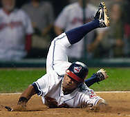 MORNING JOURNAL/DAVID RICHARD<br />Cleveland's Ronnie Belliard scores on a double by teammate Ben Broussard last night in the eighth inning.