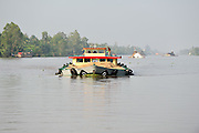 Boat on Mekong River loaded to capacity with sand. Near Cai Be, Vietnam
