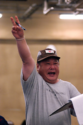 Auctioneer calling out  to sell tuna fish at famous early morning fish market at Tsukiji in Tokyo