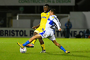 Deji Oshilaja (4) of AFC Wimbledon being challenged by Kyle Bennett (23) of Bristol Rovers during the EFL Sky Bet League 1 match between Bristol Rovers and AFC Wimbledon at the Memorial Stadium, Bristol, England on 23 October 2018.