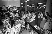 """18/12/1962<br /> 12/18/1962<br /> 18 December 1962<br /> Draw for four large Christmas hampers at Todco, Dublin. Picture shows """"General"""" Charlie Byrne drawing one of the lucky numbers watched by a large crowd of customers."""