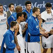 Efes Pilsen's Kerem TUNCERI (L) and Andrew WISNIEWSKI (F), Lawrence ROBERTS (3ndL) Nikola VUJCIC (C), Kerem GONLUM (2ndR), Igor RAKOCEVIC (R) during their Turkish Basketball league match Efes Pilsen between Erdemir at the Sinan Erdem  Arena in Istanbul Turkey on Saturday 29 January 2011. Photo by TURKPIX