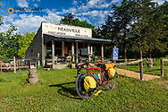 Bicycle touring along the Meadville Road and historic store in Meadville, Nebraska, USA
