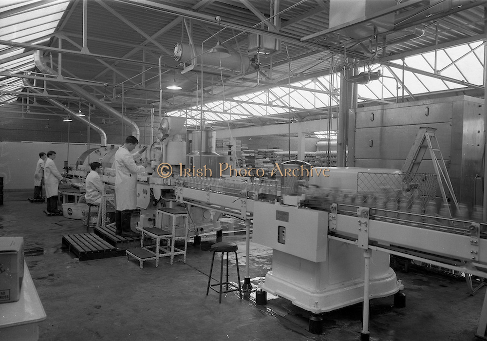 21/5/1965<br /> 5/21/1965<br /> 21/5/1965<br /> <br /> A Quality Control Officer inspects the bottles after they come off the Automatic Washer