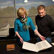 Luise Poulton, Rare Books Manager Special Collections and University of Utah student Matthew Scholl examine a leaf of the Gutenberg Bible printed between 1450 and 1455 in the rare book collection at the J. Willard Marriott Library on the campus of the University of Utah in Salt Lake City, Utah Wednesday Oct. 10, 2012. (Photo by August Miller)