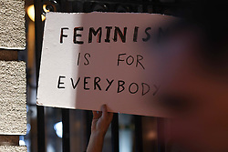 December 17, 2018 - Dublin, Ireland - An activist hold a sign 'Feminism Is For Everybody' during the Sex Workers Alliance Ireland (SWAI) candlelit vigil outside Leinster House in Dublin to mark International Day to End Violence against Sex Workers. .On Monday, December 17, 2018, in Dublin, Ireland. (Credit Image: © Artur Widak/NurPhoto via ZUMA Press)