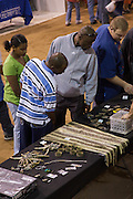 Sweetwater, TX - March 15:  Visitors view western diamondback rattlesnake heads, skins and rattles during the 51st Annual Sweetwater Texas Rattlesnake Round-Up ,  March 15, 2009 in Sweetwater, TX. During the three-day event approximately 10,000 rattlesnakes will be collected, milked and served to support charity.