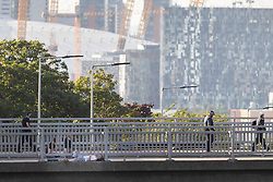 © Licensed to London News Pictures. 17/07/2020. London, UK. Police negotiators are speaking to a man (L) who is on the ledge of a bridge that passes over the A102.  Police have blocked the A102 and have cordoned off the bridge this has caused major traffic disruption in the area.  Photo credit: George Cracknell Wright/LNP