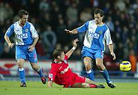Fotball<br /> Premier League England 2004/2005<br /> 21.11.2004<br /> Foto: SBI/Digitalsport<br /> NORWAY ONLY<br /> <br /> Blackburn v Birmingham<br /> Barclays Premiership. 21/11/2004. <br /> <br /> Matthew Upton of Birmingham City slides in to challenge Lucas Neill of Blackburn Rovers as David Thompson looks on.