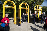 Yellow security barriers installed at Green Park in central London, England, United Kingdom. These temporary, movable barrier systems are placed strategically across the capital in the wake of terrorist threats in places where large numbers of people gather as a preventative measure.