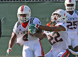August 1, 2017 - Coral Gables, FL, USA - UM's DB Jaquan Johnson (4) runs a drill with Sheldreick Redwine (22) at the University of Miami's first day of football practice for the 2017 season on Tuesday, Aug. 1, 2017 in Miami, Fla. (Credit Image: © Charles Trainor Jr/TNS via ZUMA Wire)