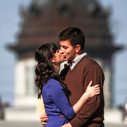 An engaged couple kisses for a portrait made near the South Carolina statehouse in Columbia, S.C. ©Travis Bell Photography