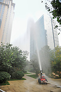 TAIYUAN, CHINA - OCTOBER 12: <br /> <br /> Intelligent robot firefighter sprays water at outdoor exhibition space during 2016 National Mass Innovation and Entrepreneurship Week on October 12, 2016 in Taiyuan, Shanxi Province of China. 2016 National Mass Innovation and Entrepreneurship Week kicked off at National High-tech Industrial Development Zones of Taiyuan on October 12. Robot firefighters are intended to be part of the firefighting equipments in the future, scanning blaze and tackling fires without risking human life. <br /> ©Exclusivepix Media
