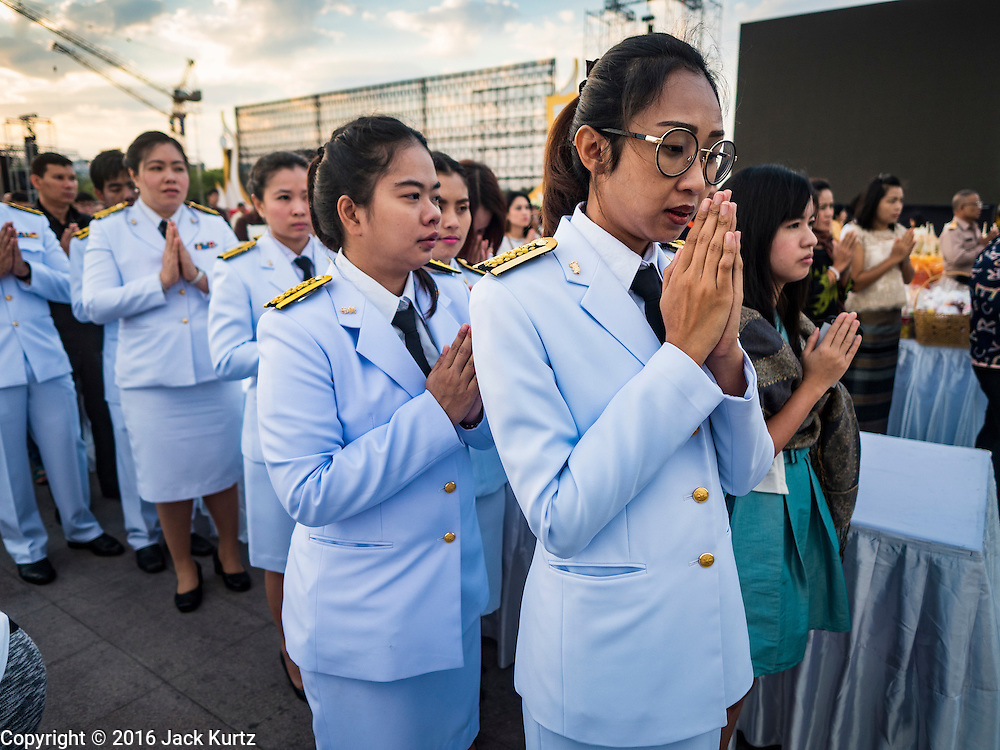 01 JANUARY 2016 - BANGKOK, THAILAND:   Thai government employees participate in the annual New Year's mass merit making ceremony on at Sanam Luang in Bangkok. The ceremony is sponsored by the Bangkok city government. More than 500 Buddhist monks participated in the ceremony this year. Thais usually go to temples and religious observances to meditate and make merit on New Year's Day.         PHOTO BY JACK KURTZ