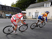 France, VEIGNE , 11 October 2009: Vincent Dauga, Entente Sud-Gascogne (ESG), leads Yann MORITZ, Vendée U (VEU), on the Côte de Crochu climb in the Paris Tours Espoirs cycle race. Dauga would finish the race in 4th place with Moritz in 7th...