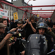 Police on motor bikes try and make their way through the protestors during the Occupy Brooklyn March over the Williamsburg Bridge, New York, USA. 1st May 2012. Photo Tim Clayton