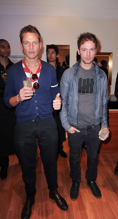 Left to right, JAMES PENFOLD and MARK MORRISON at a party to celebrate the B.zero 1 design by Anish Kapoor held at Bulgari, 168 New Bond Street, London on 2nd June 2010.