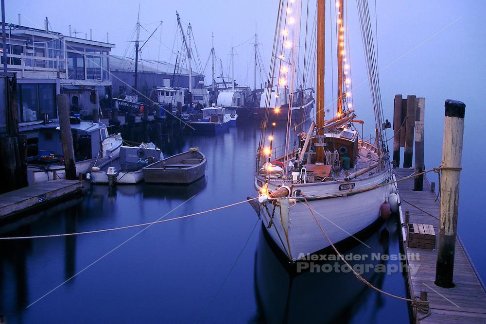 USA - Newport, RI - former flagship of Capetown, the Yacht 'Halloween' lies at her slip at Bowen's landing on a foggy winter evening.