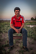 2014/11/22 – Quimili, Argentina: Santo Ramón Gonzales (35), sits on his backyard. He complains that soy producers are doing everything they can to expel his community out of their land. He says they use many different tactics like: pulverize their homes, fields and animals with glyphosate, threatening them with weapons and even claim with fake paperwork that they own the land. The indigenous people in the area are being threaten by soy producers that see their land as an opportunity to grow more of the crop. On the otherhand indigenous defend a sustainable agriculture and to live in harmony with the nature. (Eduardo Leal)
