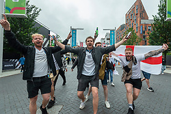© Licensed to London News Pictures. 18/06/2021. LONDON, UK.  England football fans arrive for the Euro 2020 Group D match between England and Scotland match at Wembley Stadium. The tournament was postponed from 2020 due to the COVID-19 pandemic in Europe and rescheduled for 11 June to 11 July 2021 with matches to be played in 11 cities. Wembley Stadium will host certain group matches, as well as the semi-finals and final itself.  Photo credit: Stephen Chung/LNP
