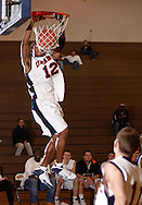 Middletown, N.Y. - Orange County Community College men's basketball player Stefan Bonneau, a 5-foot-9 guard, dunks the ball during a game against Queensborough Community College on Feb. 4, 2006. ©Tom Bushey/The Image Works.