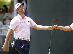 May 26, 2018 - Fort Worth, TX, USA - Jon Rahm fist bumps his caddie after a big putt shot during the Fort Worth Invitational Golf Tournament at Colonial Country Club Saturday May 26, 2018 in Fort Worth, Texas. (Credit Image: © Bob Booth/TNS via ZUMA Wire)
